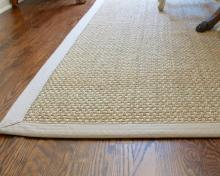 Seaside custom seagrass rug with matching border. Photo by Sheila Irwin