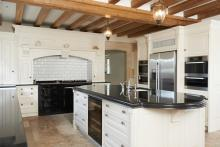 luxury fitted kitchen with a beamed ceiling