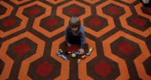 Boy Playing on a Patterned Carpet